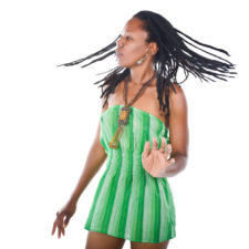 Rasta woman with green dress dancing reggae