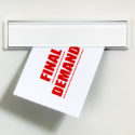 Final demand notice on letter being delivered through a letterbox concept for unpaid bill, late payment and repayment financial worry