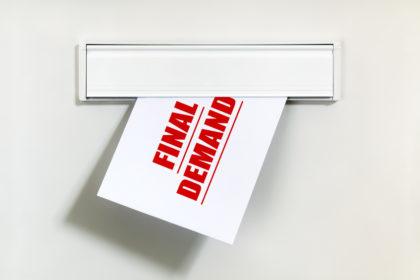 Unpaid bill through the letterbox