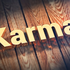 """Good karma is clean karma. The word """"Karma"""" is lined with gold letters on wooden planks. 3D illustration graphics"""