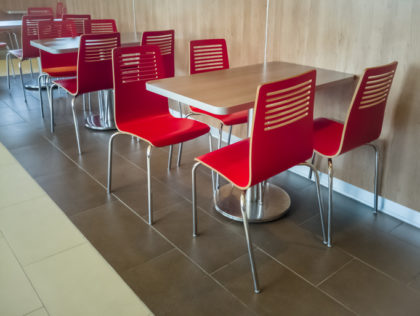 Red cafeteria diner chairs and tables
